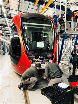 Workers at Alstom's La Rochelle, France-based production facility work on a Citadis X05 light rail vehicle.
