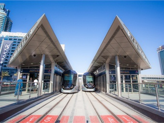 The tram system includes 11 air-conditioned stations along the six-mile line, which feature information kiosks, ticket validators and vending machines, public address systems, video monitors and CCTV systems.