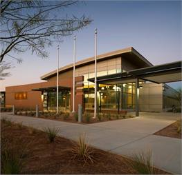 The 250-bus East Valley Bus Operations and Maintenance Facility in Tempe, Ariz., designed by RNL and completed in 2007, features a highly-reflective roofing membrane for flat roofs; oil/water separator to filter storm water run-off; metal canopies over buses to reduce heat island effect; drought-resistant native landscaping; and a bus washer that reclaims and reuses 100% of available water.
