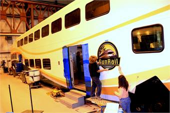 Bombardier is building 14 bi-level units for Phase 1, per a $41.7 million contract. The company will also provide operations and maintenance services for the first 10 years of the rail service.