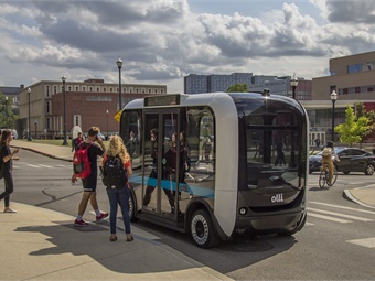 Local Motors' accessible version of its Olli driverless, electric shuttle (shown) can direct a passenger who is visually impaired, to empty seats using machine vision to identify open spots and audio cues to direct the passenger. Local Motors