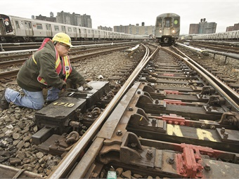 Workers at New York City Transit's Coney Island Yard threw switches by hand as a result of storm damage. Photo: MTA/Patrick Cashin