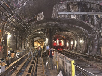 Working on the damaged Montague Tubes along the R line in Brooklyn. Photo: MTA/Patrick Cashin
