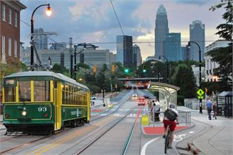 The FTA and the Department of Commerce's manufacturing assistance programs collaborated to help the utilities find domestic components for the necessary utilities relocation as part of the Charlotte, N.C. streetcar project (rendering shown).