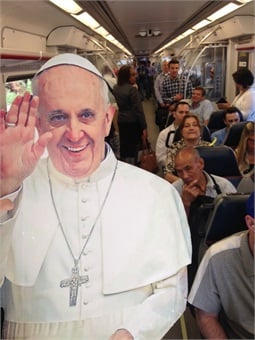 "Earlier this summer, SEPTA's marketing team did a ""PopUpPope"" promotion, where they took pictures of a Pope cutout posed at different stations and on trains and buses to help promote travel on the system during the Papal Visit."