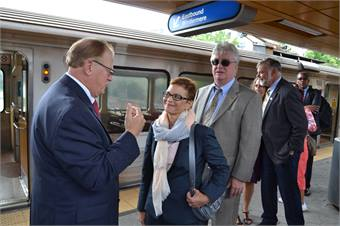 McMillan talks with Greater Cleveland Regional Transit Authority CEO Joe Calabrese during a tour of the new Cedar-University Rapid Station.