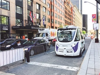 Electric autonomous vehicles, like the one pictured here during a demonstration at the 2017 UITP Summit in Montreal, are seen as a key mode in a smart city plan. Photo by METRO Magazine/J. Starcic