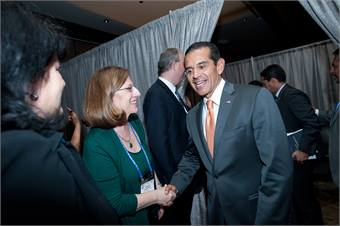 Miller shown with then-Los Angeles Mayor Antonio Villaraigosa at APTA's 2012 Annual Awards ceremony, says she is proud of her work managing the annual event.
