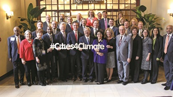 At least 369 U.S. mayors, including those pictured here at a U.S. Conference of Mayors meeting, have adopted the Paris climate agreement. Photo via Compact of Mayors.