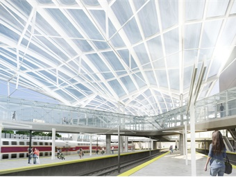 Expansive ETFE Canopy over platforms with elevated walkways connecting concourses.
