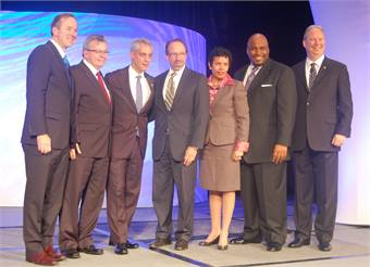 From left to right: Forrest Claypool, Peter Varga, Chicago Mayor Rahm Emanuel, Peter Rogoff, Flora Castillo, Terry Peterson and Michael Melaniphy at APTA's Opening General Session on Monday.