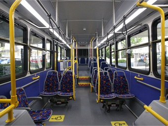 Interior features of Sacramento RT's buses include foldaway stanchion seating up front as well as a section of flip-up seating to accommodate folded carts and packages, increased legroom and a clear rooftop emergency hatch that allows in natural light.