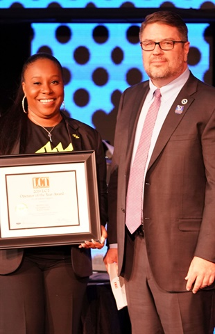Robert Gaskill (R), co-founder and CEO of MOTEV in Los Angeles, and Tiffany Hinton, chief administrative officer, accept the 2019 LCT Operator of the Year Award on March 26, 2019 during the International LCT Show in Las Vegas. (LCT file photo)