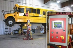 Mohawk's mobile lifts are available with this 7-inch touchscreen control (at right), which shows the total weight being raised by all columns and the number of cycles per technician.