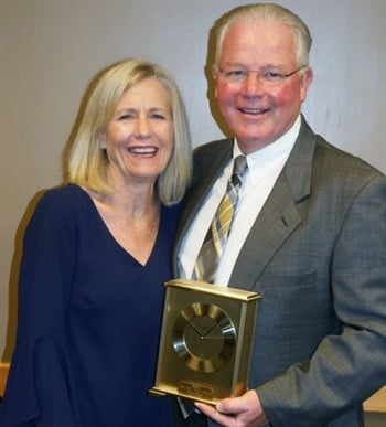 Pat Regan, shown here with his wife, Mary Regan, received the Jim DeVeau Award, which honors individuals who have devoted themselves to school bus safety.