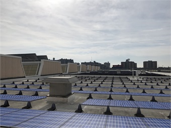 Roof of Coney Island Maintenance Facility with solar panel renderings.