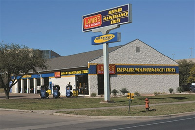Comparisons show the new look of the Lamb's Tire and Automotive store in Lake Creek, Texas, before rebranding and after the remodel. The company replaced Goodyear graphics with colors and signage consistent with Lamb's Tire branding.