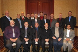 National Express Corp. CEO David A. Duke (front row, third from right) and G.P. Singh, senior vice president, fleet maintenance and engineering (second row, fourth from right), were among the attendees of a dinner to honor 15 employees who received ASE master technician certification.