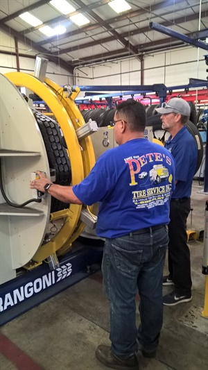 Pete's Road Service has joined the Marangoni network. Pictured in the dealership's retread plant are Noe Lara (left), operations manager, and Kyle Fletcher, president.