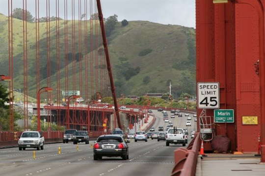 A grand jury in Marin County, north of San Francisco, is calling for a coordinated school bus service to curb traffic congestion. Seen here is the Marin County line on the Golden Gate Bridge. Photo by Daniel Schwen via Wikimedia Commons