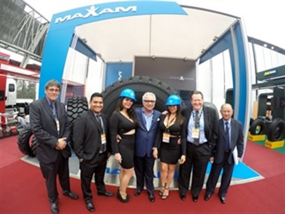 Gus Lima, center, was part of the team selling Maxam Tires at the mining show Sept. 14-16 in Peru.