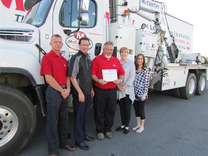 McCarthy Tire Service is the nation's first commercial tire dealer with an advanced OTR tire trainer on staff. Mark Shimko, center, is pictured with, from left, Russell Devens, director of safety and risk management; John McCarthy Jr., company president; Tracy Schooley, director of human resources; and Mary Kate Lambert, human resource generalist.
