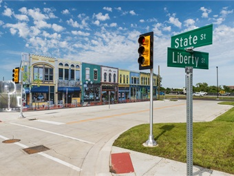 Mcity includes a network of roads with intersections, traffic signs and signals, streetlights, building facades, sidewalks and construction obstacles. Photo: University of Michigan