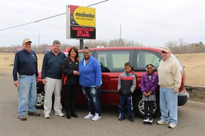 Georgetta from Blaine, Minn. receives a car that Meineke franchisees Mark and Barbara Koloff helped repair in partnership with a local charity.