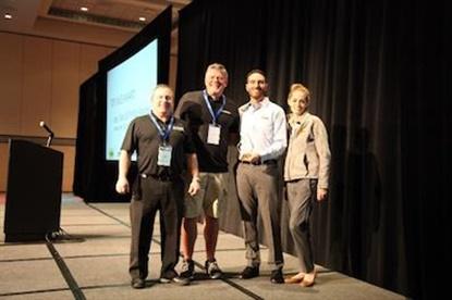David Repass, second from left, celebrates hisTop Sales Award alongsideMeineke's Rob Fillman, Danny Rivera and Kristi Kanzig.