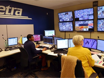 Metra communications specialists working on the Metra Electric Line desk in the GPS Center on Tuesday, Dec. 5. Photo: Metra