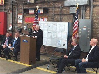 FRA Administrator Ronald Batory congratulates Metra workers on completing a key positive train control milestone - all equipment installed. Photo: Metra
