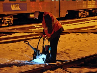 Track worker thawing out a switch. Photo: Metra/Mark Llanuza