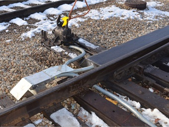 Switch cover focuses the heat on the switching mechanism to prevent ice and snow from building up on it. Photo: Metra
