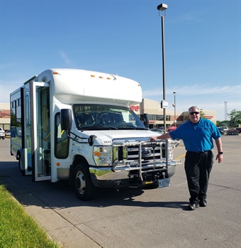 Milan Microtransit driver, Kevin Huechteman, starts the first day of microtransit service in the Village of Milan, IL. MetroLINK