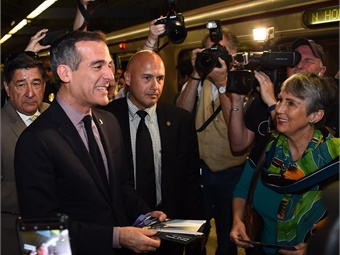 Los Angeles Mayor and Metro Board Chair Eric Garcetti Rides the Metro Red Line subway handing out complimentary 25th Birthday TAP cards to riders.