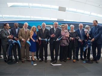 DTPW Director Alice N. Bravo, (fourth from left) attended the ribbon-cutting event for the new railcars.