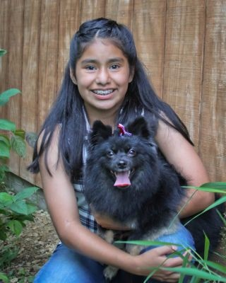 Miana was born in Guatemala and adopted at 8 months old. Now a seventh grader in Rosemount, Minnesota, she enjoys playing soccer and ice skating.