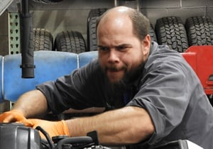 Mike McMath concentrates while performing engine diagnostic work.