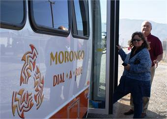 Debbie Dailey, a tribal elder with the Morongo Band of Mission Indians, and bus driver Rosco Funkhauser with one of the new Morongo Dial-A-Ride vehicles.