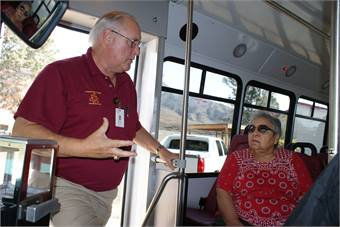 Bus driver Rosco Funkhauser explains the dial-a-ride program to a rider.
