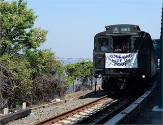 A ceremonial Nostalgia Train crosses the South Channel Bridge on its way to Rockaway Park. Photo: MTA New York City Transit / Marc A. Hermann