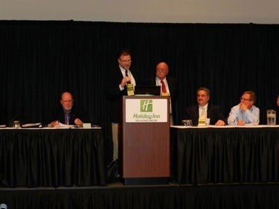 The 17th National Congress on School Transportation (NCST), which was to take place in May 2020, has been postponed. Murrell Martin (shown left at podium) and Bill Loshbough are pictured here leading a discussion at NCST 2015.