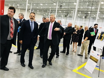 (Left to right) Dan Murray, GM, New Flyer's Shephersville plant; Gov. Matt Bevin; Paul Soubry, New Flyer CEO tour the new Shepherdsville, Ky., facility during the grand opening event on Sept. 10, 2018. Photo: METRO Magazine