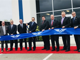 (From L to R) Curtis Hockenbury, Mayor of Shepherdsville, Ky.; John Snider, executive director, Bullitt County Economic Development Authority; New Flyer of America President Wayne Joseph; Gov. Matt Bevin; Dan Murray, GM, New Flyer's Shephersville plant; Congressmen Brett Guthrie; Paul Soubry, New Flyer CEO; and Terry Gill, secretary, Kentucky Cabinet for Economic Development at the ribbon cutting for New Flyer's new Kentucky fabrication facility.