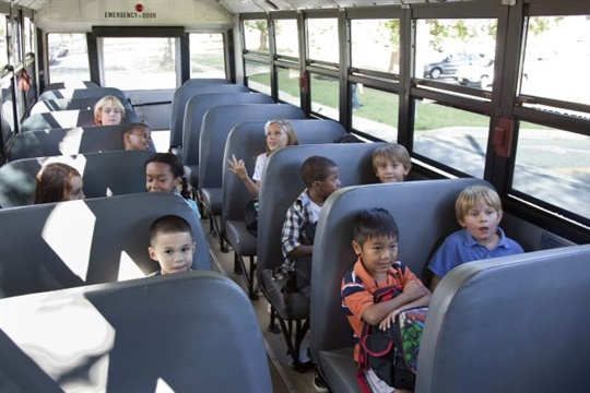 """In a new report, a Louisiana task force finds that """"compartmentalized seating and other occupant restraint usage … generally have met the safety needs of Louisiana's school bus passengers."""" Stock photo by NHTSA"""