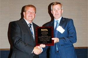 NSTA President Tim Flood (left) presented John Turney of Landmark Student Transportation in Aurora, Ontario, with a Golden Merit Award.Photo courtesy NSTA