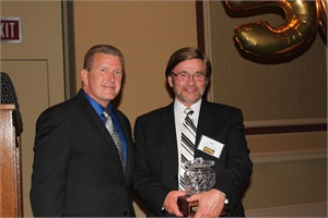 """NSTA President Tim Flood (left) presented Robert """"Bob"""" Pudlewski of Fleet Ops Consulting with the Hall of Fame Award."""