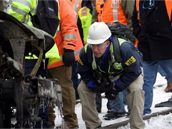 NTSB recorder specialist George Haralampopoulos search for event recorder in the Metro North train.NTSB
