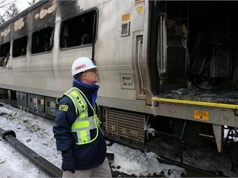 Board Member Robert Sumwalt views damaged rail car involved in Metro North train accident. NTSB