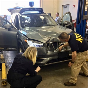 NTSB investigators on-scene in Tempe, Arizona, examining the Uber automated test vehicle involved in the collision. Photo by NTSB